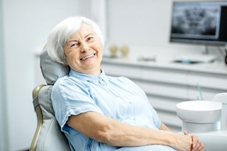 An older woman smiling in the dentist's chair