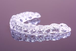 Clear aligner tray for invisible braces