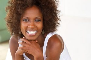 woman happy with cosmetic dentist in Fort Worth